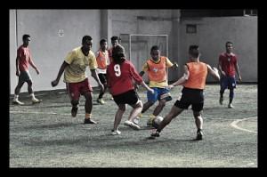 street_soccer_world_cup_kids_plaing_red_orange_soccer_ball_vest_goal_fun_children_somebody_photo__opt